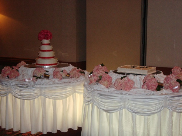 Cake Topper of Roses with the pink Hydrangeas around the table